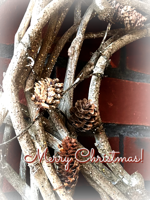 A wreath of pine bent twigs and pine cones to welcome visitors
