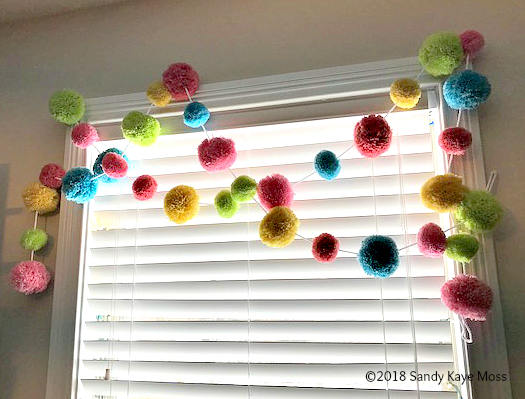 Pom Pom garlands are a must in art studios!