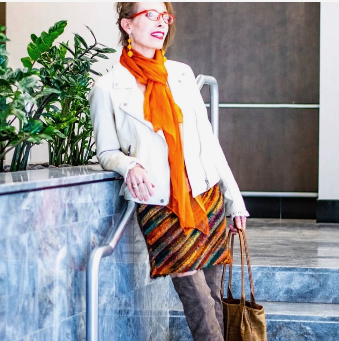 Woman with striped skirt and orange scarf