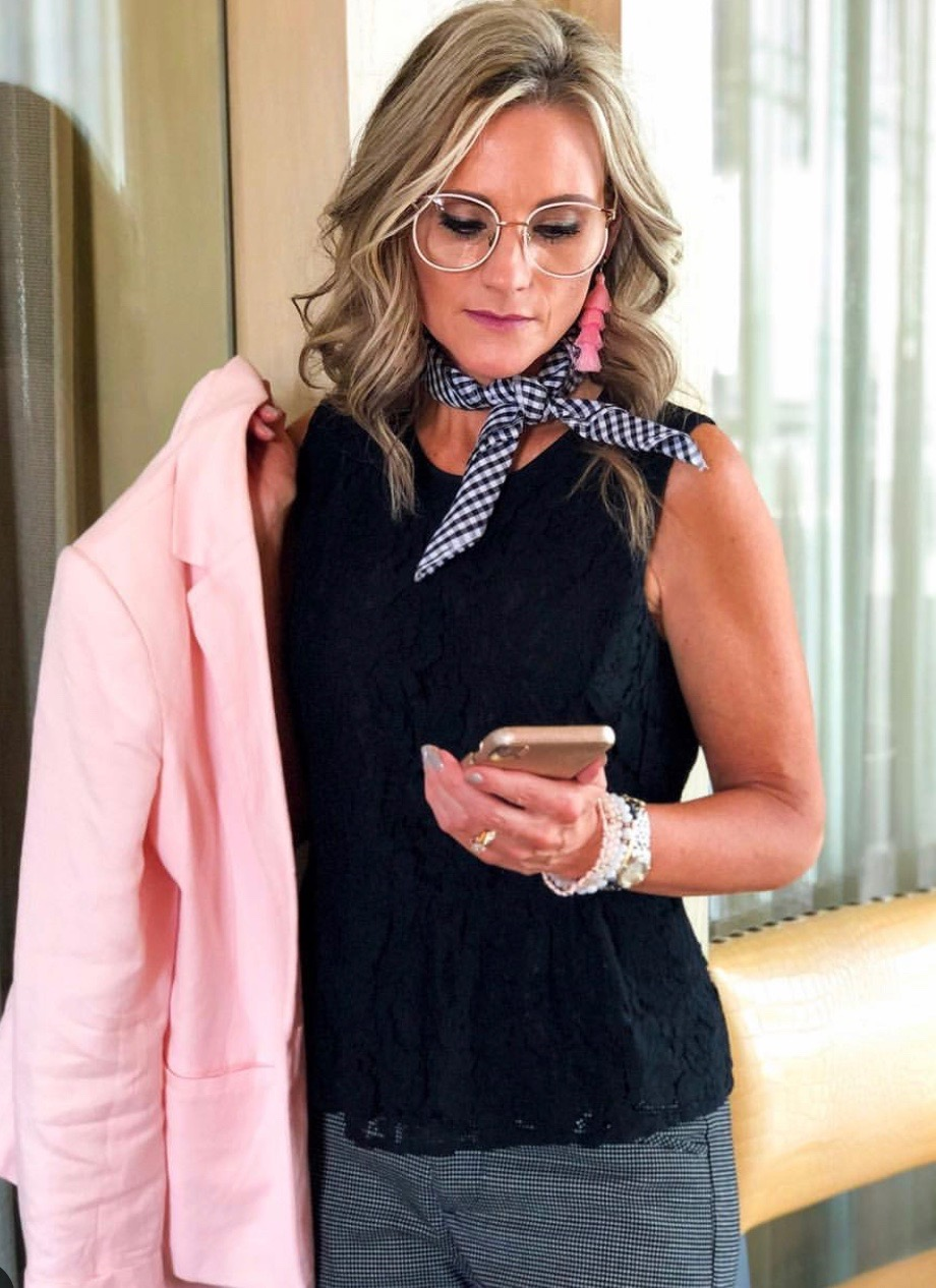 Woman with pink blazer and cell phone