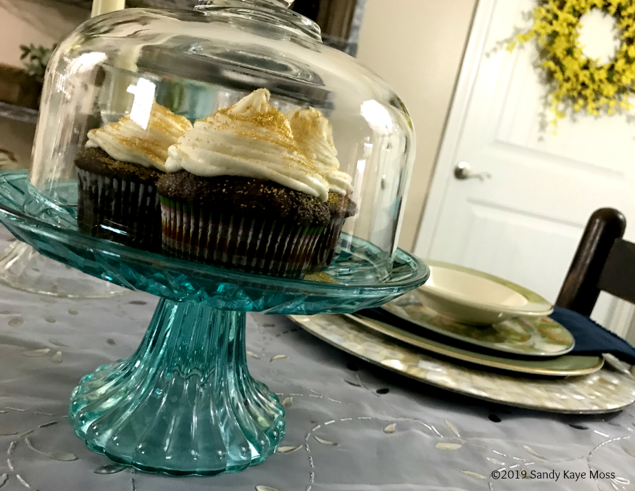 cupcake, dinner place setting, wreath on door